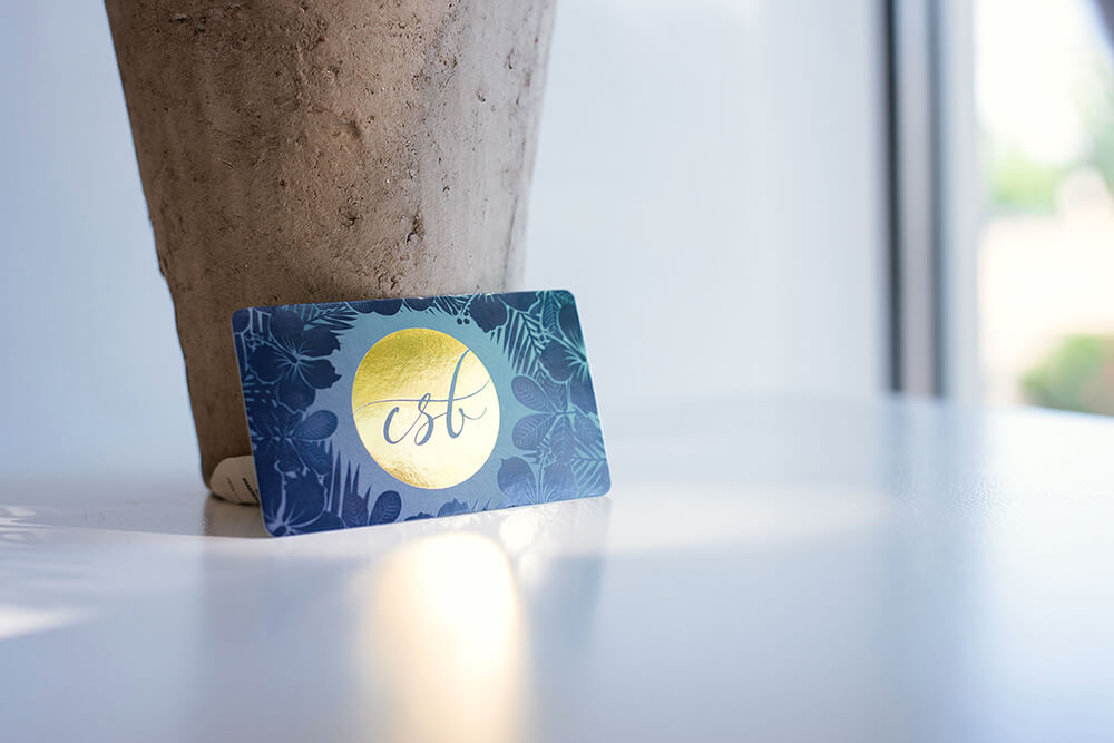 Design your own business cards and make them pop by adding stamped foil.