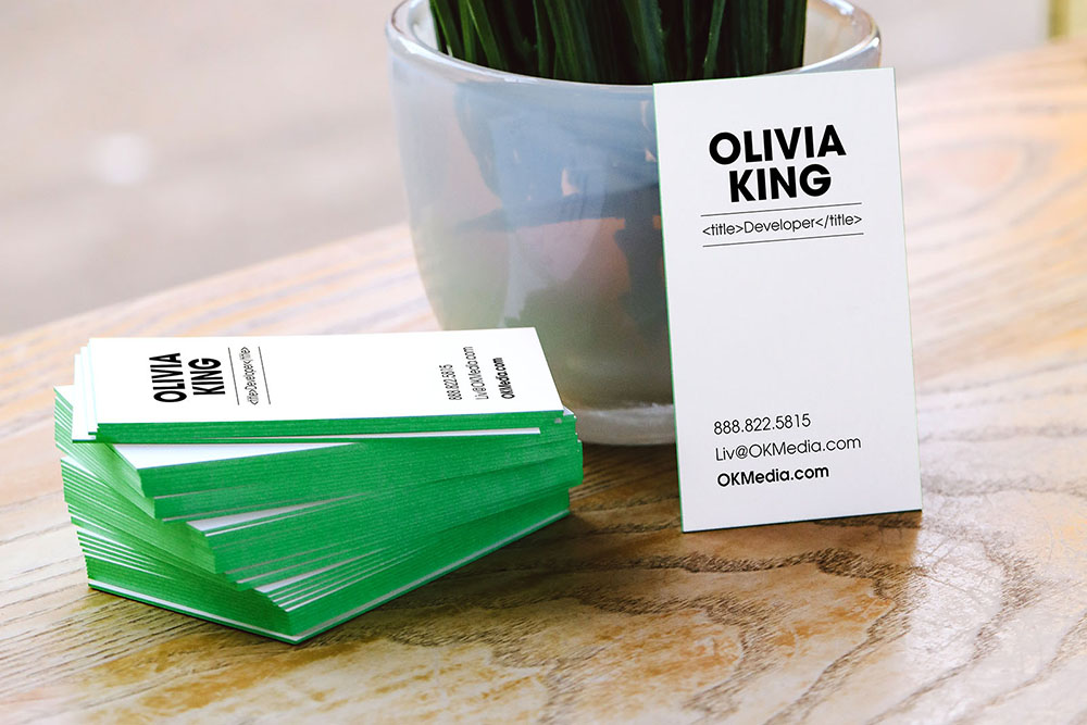 Green painted edge business cards.