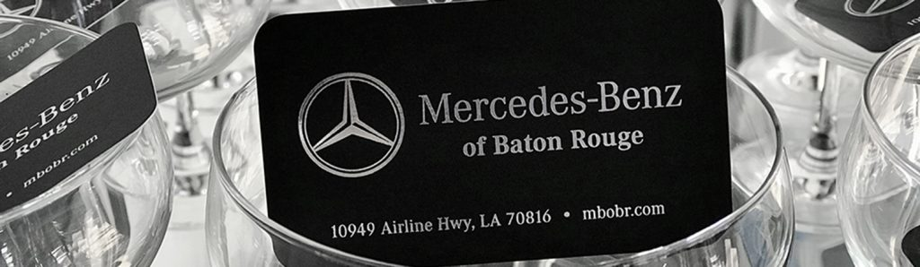 Black buisness card with silver stamped foil.