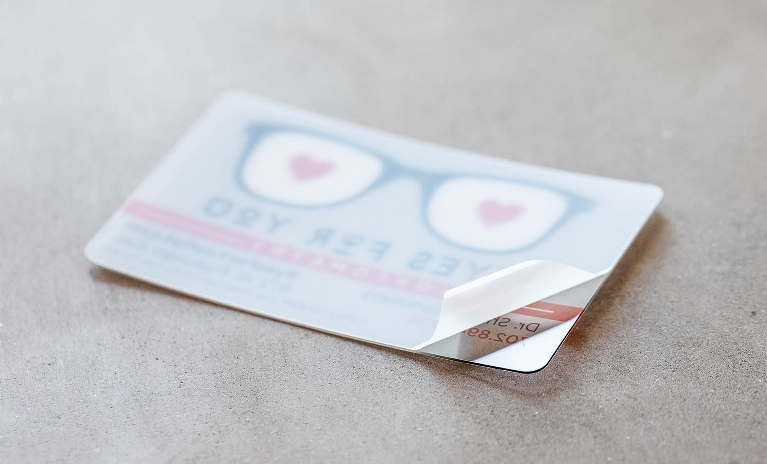 All our Clear Plastic Business Cards come with a protective film to prevent them from scratching during production and/or shipping.