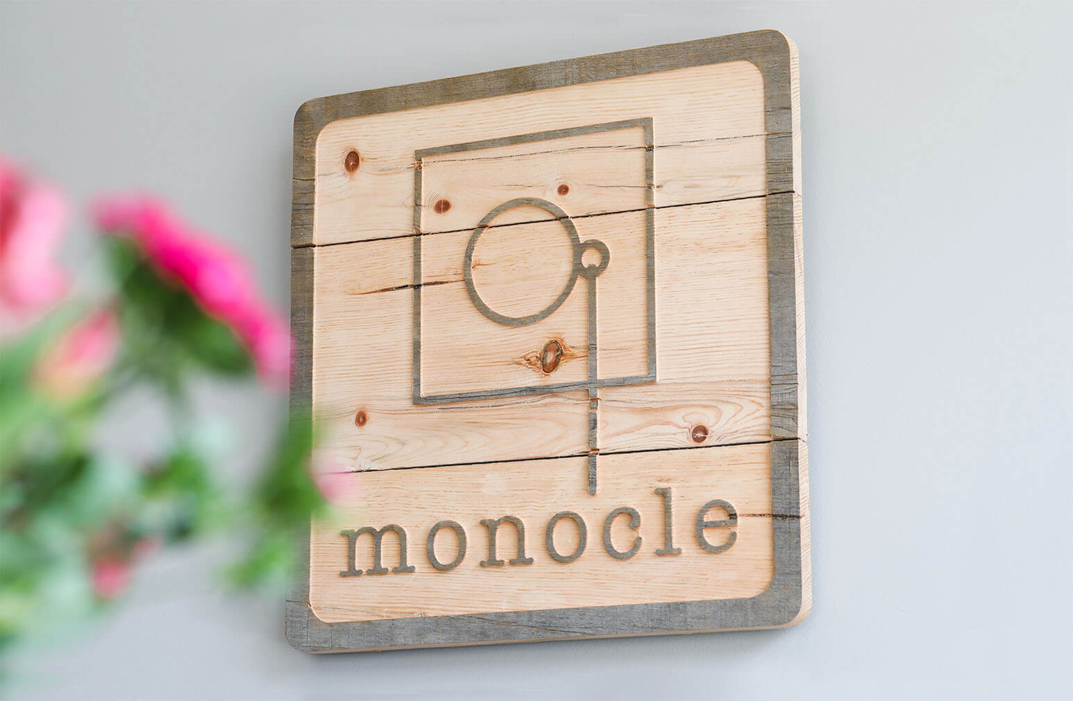 Custom logo design for Monocle Eye Care & Eyewear Gallery.