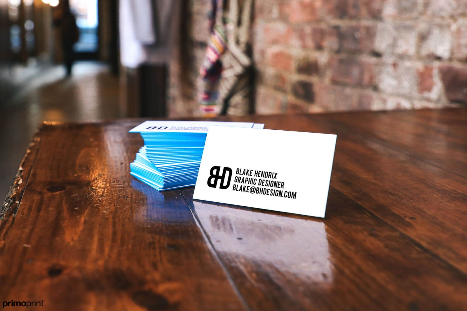 Blue painted edge business card printed on 32PT thick uncoated card stock.