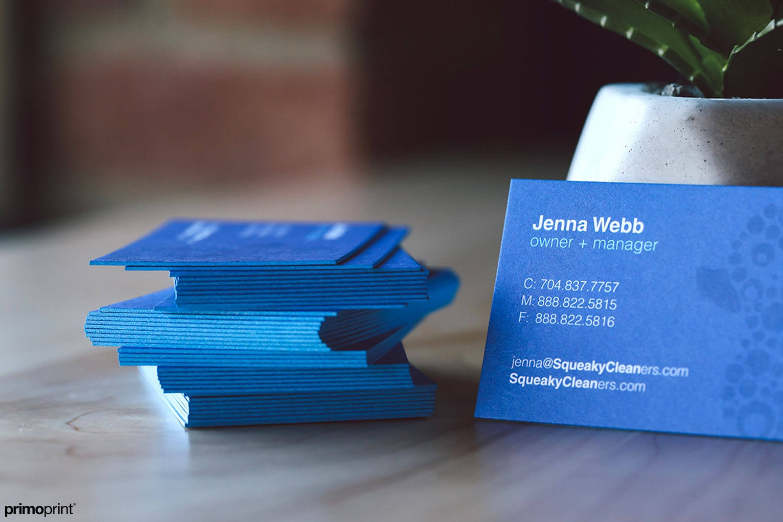 Printed on 32PT thick uncoated card stock. Designed in-house by Primoprint graphic designer.