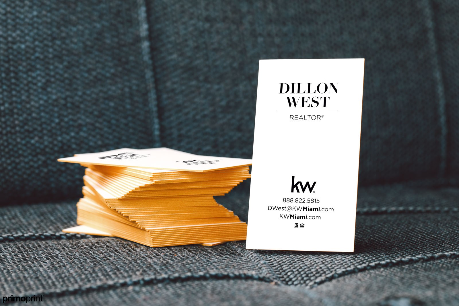 32PT thick uncoated business card with gold painted edges.