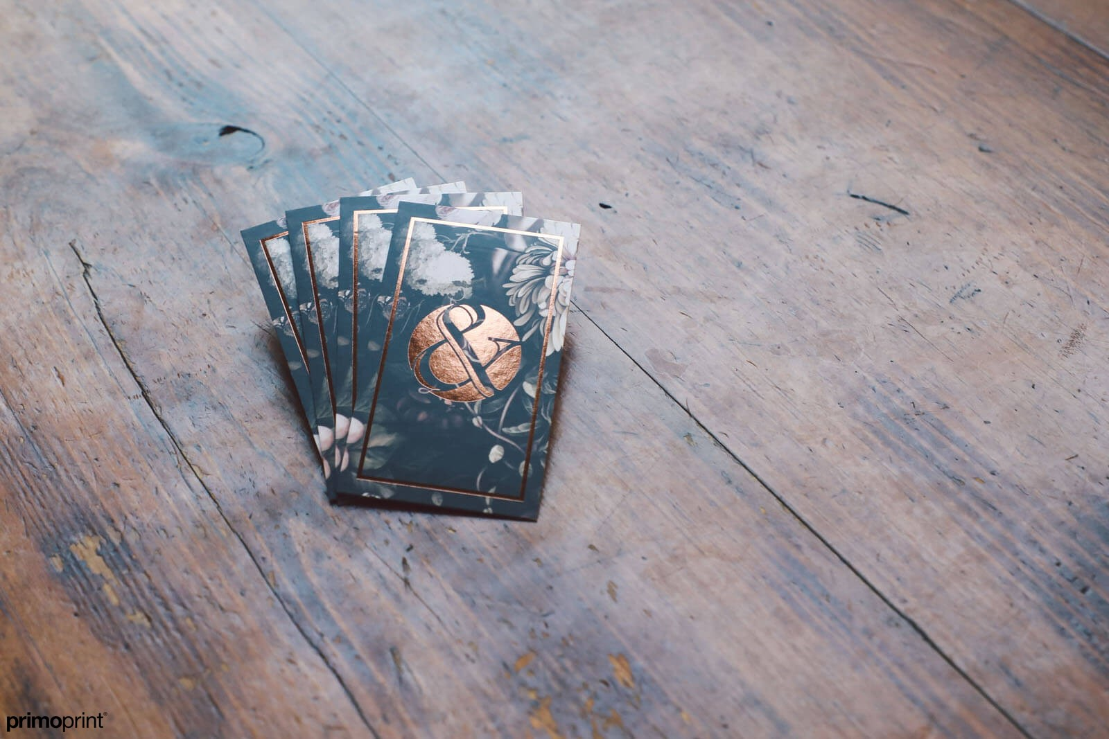 Premium 19PT Silk business card with copper Stamped Foil.